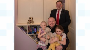Wayne Jones (back) with Paul Henderson and twins Amelia and Gracie Wilson, in the girls' new bedroom