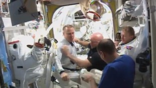 The astronauts returned safely to the Quest airlock on board the ISS with Colonel Kopra handing over his suit and a syringe of the water in his helmet.