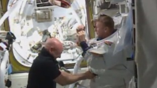 Scott Kelly helped Tim Peake out of his spacesuit after the British astronaut returned to the ISS.