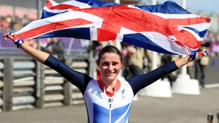 Sarah Storey with a GB flag paralympics time trial