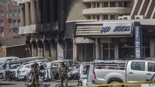 The charred remains of cars outside the hotel in the aftermath of the siege