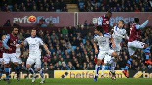 Leicester City's Jamie Vardy (second from right) rises to get a header on goal at Villa Park in Birmingham.