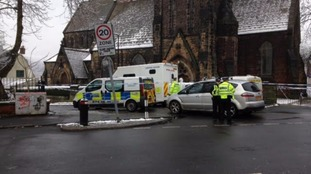 Forensic teams investigate after a body was found in Leeds