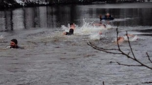 Hardy swimmers brave the freezing water