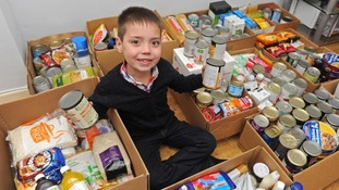 Eight-year-old boy starts his own food bank after being upset by documentary on the hungry