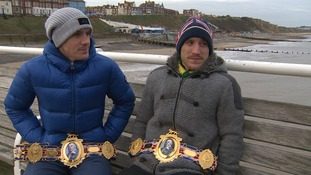 The Walsh brothers show off their belts.