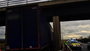 The lorry got stuck under a bridge
