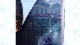 MSP Joan McAlpine's constituency office window was smashed by vandals caught on CCTV