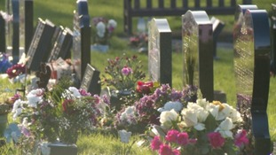 Flowers at grave stones