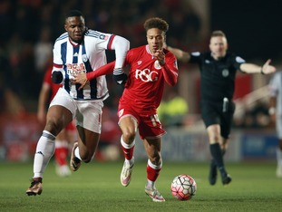 Bristol City's Bobby Reid is challenged by West Bromwich Albion's Victor Anichebe