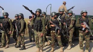 Soldiers gathered outside Bacha Khan University