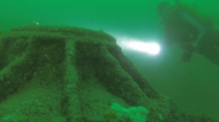 Divers investigate the sunken U-boat.