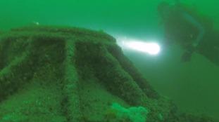 Divers investigate the sunken U-boat.