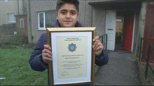 13-year-old Jibril Muhammed Faris with his certificate from West Yorkshire Fire service