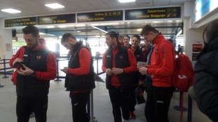 The Grecians check in for their flight to Liverpool.
