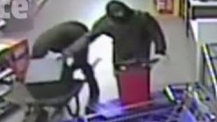 CCTV shows ram-raiders using wheelbarrow to take away stolen goods