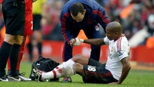 Ashley Young receives treatment for an injury during the Barclays Premier League match at Anfield.