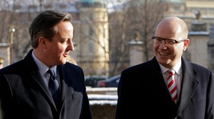 David Cameron is welcomed by Czech Prime Minister Bohuslav Sobotka at government headquarters in Prague
