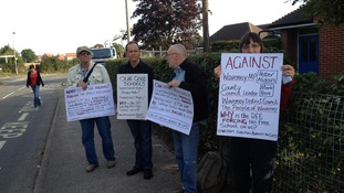 Protestors outside the Beccles Free School which opened today