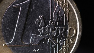 Map of Europe on the face of a one Euro coin