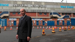 Coroner Lord Justice Goldring outside the Hillsborough stadium in Sheffield