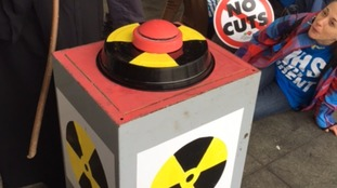Protesters had a red button for members of the public to press to symbolise the much talked about nuclear-trigger