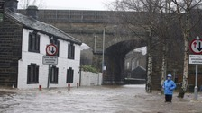 The River Calder burst its banks at Mytholmroyd, flooding the town