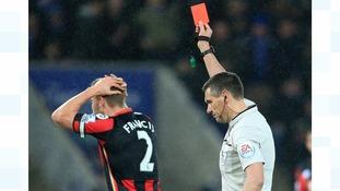 Referee at football match
