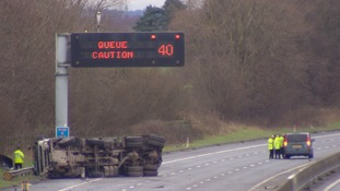 A woman has died and a man is seriously injured after a lorry overturned on the M62.
