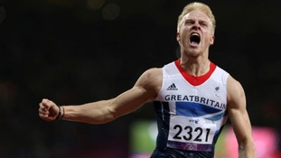 Gold for Britain's Jonnie Peacock in a record-breaking victory in the men's 100 metre T44