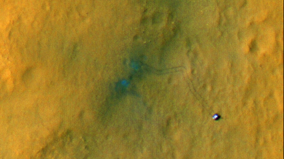 Tracks from the first drives of NASA's Curiosity rover are visible
