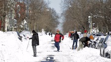 People clear snow following the storm in Washington.