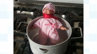 Doll in a cooking pot