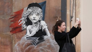 Banksy used the iconic image of a young Cosette from Les Misérables in an attack on the French authorities