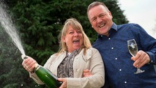 Susan Richards and partner Barry Maddox celebrating her £3 million lottery win.