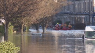 escue boats on a flooded street in York