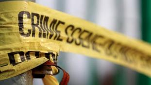 Police tape in Salford