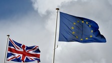 The Union flag flutters next to the EU flag