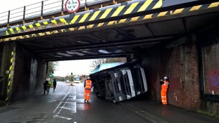 The lorry was left on its side as it failed to fit under the bridge