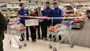 Carlisel United players were on hand to officially re-open the store