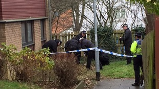 Police officers at the scene where a body has been found in Northamptonshire