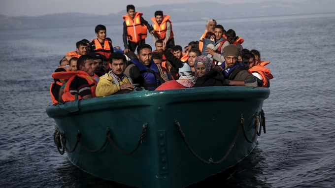 Migrants arrive in an overcrowded boat to the Greek island of Lesbos
