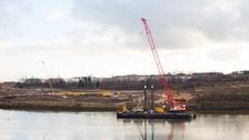 The arrival of the Claude Monique in the river where the bridge is to be built has marked a gear change for the project.