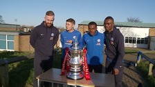 The Peterborough United players pose with the FA Cup trophy.
