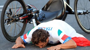 Italy's Alessandro Zanardi kisses the track to celebrate winning the Gold Medal in the Men's Individual H 4 Road Race