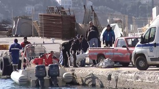 Bodies from the latest tragedy are brought to the shore.