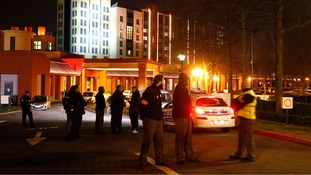Police and security at the New York Hotel where the man was arrested.