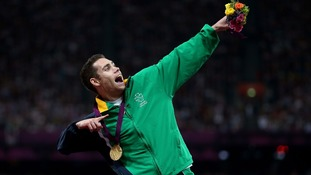 Ireland's Jason Smyth celebrates with 200m Gold medal on the podium at the Olympic Stadium