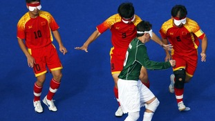 Ricardo Steinmetz of Brazil (pictured in the green shirt) in action against China.