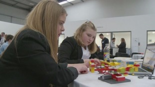School children compete to build the best Lego robot